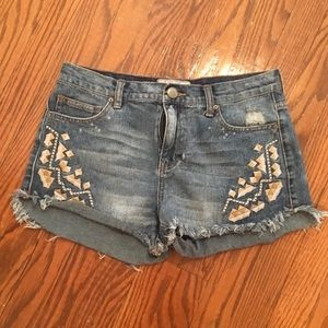 FP distressed denim shorts